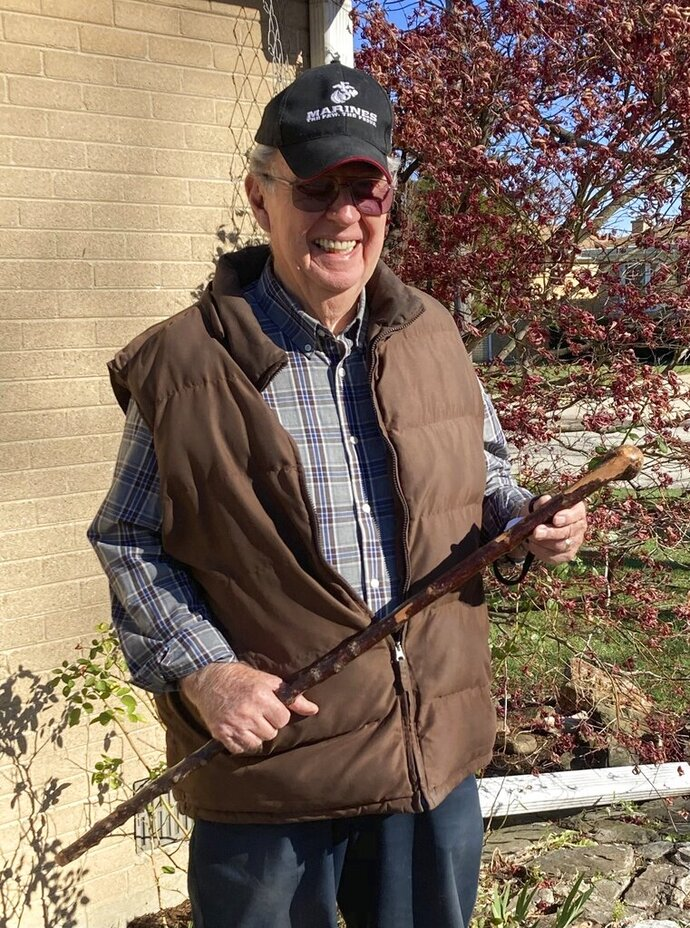Dan Donovan holds the shillelagh, an Irish walking stick, that he used to chase intruders from his Niles home, Tuesday, Nov. 17, 2020 in Niles, Ill. Donovan, an 81-year-old former Marine from suburban Chicago used his grandfather's antique Irish walking stick to chase off three burglars and deliver one a thump in the head for his trouble.(Jennifer Johnson/Chicago Tribune via AP)