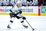 Los Angeles Kings defenseman Sean Walker (26) moves to score a gaol against the Colorado Avalanche during the first period of an NHL hockey game Thursday, May, 13, 2021, in Denver. (AP Photo/Jack Dempsey)
