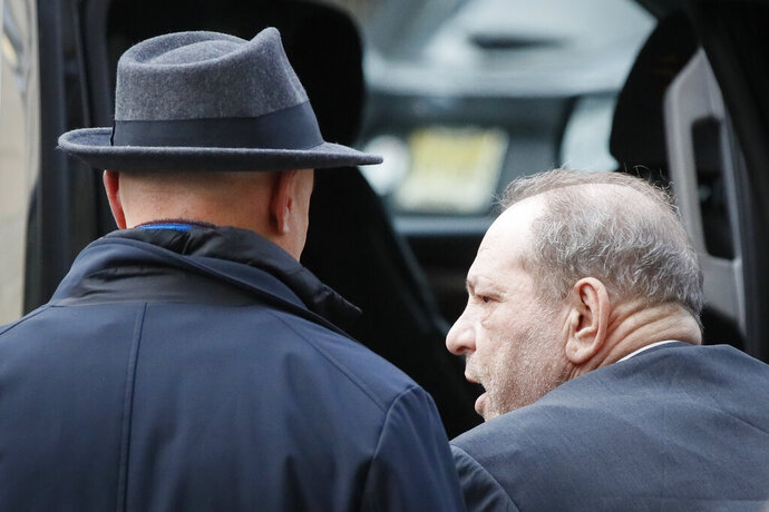 Harvey Weinstein leaves a Manhattan courthouse during his rape trial, Thursday, Feb. 20, 2020, in New York. (AP Photo/John Minchillo)