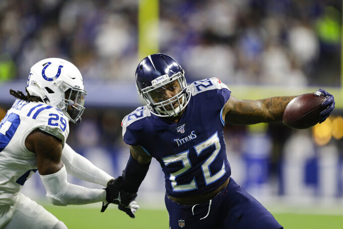 Tennessee Titans running back Derrick Henry (22) breaks the tackle of Indianapolis Colts free safety Malik Hooker (29) on his way to a touchdown during the second half of an NFL football game in Indianapolis, Sunday, Dec. 1, 2019. (AP Photo/Darron Cummings)
