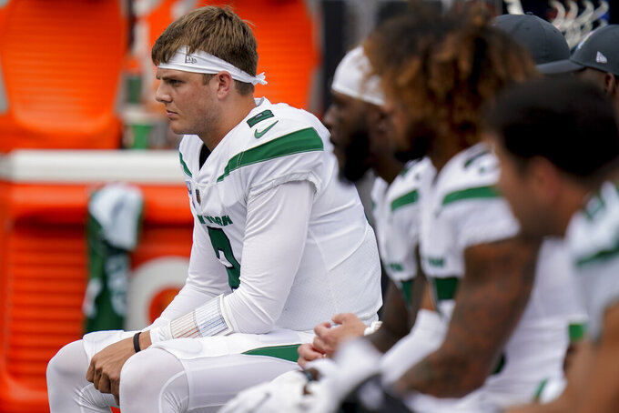 New York Jets quarterback Zach Wilson sits on the bench during the first half of an NFL football game against the Tennessee Titans, Sunday, Oct. 3, 2021, in East Rutherford. (AP Photo/Seth Wenig)