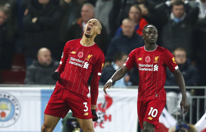 Liverpool's Fabinho celebrates after scoring his side's opening goal during the English Premier League soccer match between Liverpool and Manchester City at Anfield stadium in Liverpool, England, Sunday, Nov. 10, 2019. (AP Photo/Jon Super)