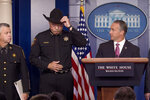 Immigration and Customs Enforcement Director Matt Albence, right, accompanied by sheriffs from around the country including Tarrant County, Texas Sheriff Bill Waybourn, center, speaks in the Briefing Room at the White House in Washington, Thursday, Oct. 10, 2019. (AP Photo/Andrew Harnik)