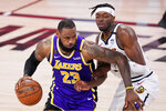 Los Angeles Lakers' LeBron James (23) drives against Denver Nuggets' Jerami Grant during the second half of an NBA conference final playoff basketball game Saturday, Sept. 26, 2020, in Lake Buena Vista, Fla. (AP Photo/Mark J. Terrill)