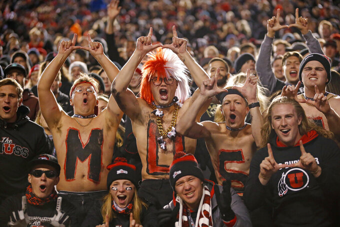 Utah fans celebrate in the first half of an NCAA college football game against California Saturday, Oct. 26, 2019, in Salt Lake City. (AP Photo/Rick Bowmer)