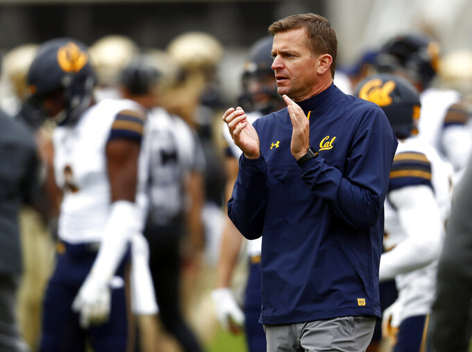 FILE - In this Oct. 28, 2017, file photo, California head coach Justin Wilcox claps during the first half of an NCAA college football game in Boulder, Colo. California coach Justin Wilcox has always emphasized to his players the importance of keeping an even keel approach every week. With a pivotal Pac-12 game against rival Stanford, Wilcox is relaxing his approach a little. (AP Photo/David Zalubowski, File)