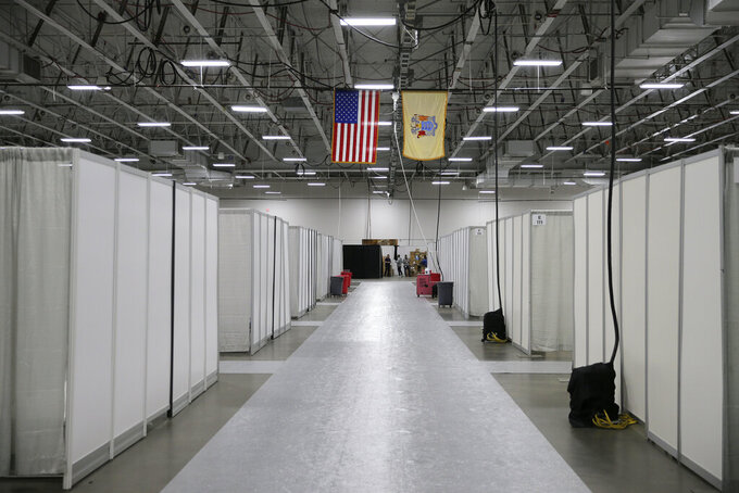 The field medical station set up at the Meadowlands Exposition Center is nearly complete in Secaucus, N.J., Thursday, April 2, 2020. New Jersey Gov. Phil Murphy toured the medical station that is expected to open early next week. It is slated to field non-coronavirus cases. It's one of four such facilities that are supposed to open in New Jersey. (AP Photo/Seth Wenig)