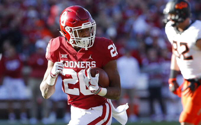 Oklahoma running back Kennedy Brooks (26) runs in for a touchdown against Oklahoma State in the second quarter of an NCAA college football game in Norman, Okla., Saturday, Nov. 10, 2018. (AP Photo/Alonzo Adams)