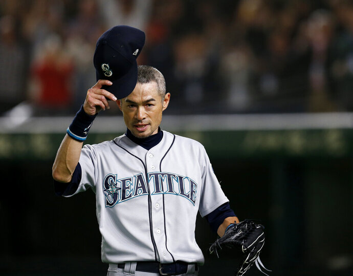 Seattle Mariners right fielder Ichiro Suzuki waves to spectators while leaving the field for defensive substitution in the eighth inning of Game 2 of the Major League baseball opening series against the Oakland Athletics at Tokyo Dome in Tokyo, Thursday, March 21, 2019. (AP Photo/Toru Takahashi)