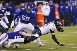 New York Giants outside linebacker David Mayo (55) stops Philadelphia Eagles quarterback Carson Wentz (11) in the first half of an NFL football game, Sunday, Dec. 29, 2019, in East Rutherford, N.J. (AP Photo/Seth Wenig)