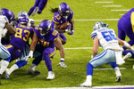 Minnesota Vikings running back Dalvin Cook (33) scores on a 1-yard touchdown run ahead of Dallas Cowboys linebacker Leighton Vander Esch (55) during the first half of an NFL football game, Sunday, Nov. 22, 2020, in Minneapolis. (AP Photo/Jim Mone)