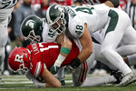Rutgers quarterback Johnny Langan (17) is sacked by Michigan State defensive end Kenny Willekes (48) and linebacker Noah Harvey (45) during the second half of an NCAA college football game Saturday, Nov. 23, 2019, in Piscataway, N.J. Michigan State won 27-0. (AP Photo/Adam Hunger)