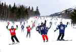 Fans of the New England Patriots NFL football team head downhill at the Sugarloaf ski resort, Sunday, Feb. 3, 2019, in Carrabassett Valley, Maine. About 200 skiers took part to show their support for the Patriots prior to today's Super Bowl game against the Los Angeles Rams. (AP Photo/Robert F. Bukaty)