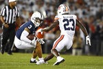 Penn State wide receiver Parker Washington (3) looks to elude Auburn cornerback Roger McCreary (23) during an NCAA college football game against Auburn in State College, Pa., on Saturday, Sept. 18, 2021. (AP Photo/Barry Reeger)
