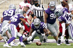 Kansas State defensive back Wayne Jones (4) recovers an Arkansas State fumble during the first half of an NCAA college football game Saturday, Sept. 12, 2020, in Manhattan, Kan. (AP Photo/Charlie Riedel)