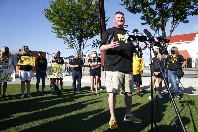 Jay Kallenberger, parent of two University of Iowa football players, speaks at a press conference asking for more transparency and communication by the Big Ten outside of their headquarters on Friday, August 21, 2020 in Rosemont. Parents of Big Ten football players, upset over the process that led to the postponement of the season until spring,  held a protest near the conference's Chicago-area headquarters Friday while an attorney in Nebraska demanded commissioner Kevin Warren turn over material illustrating how the decision was made. (Stacey Wescott/Chicago Tribune via AP)