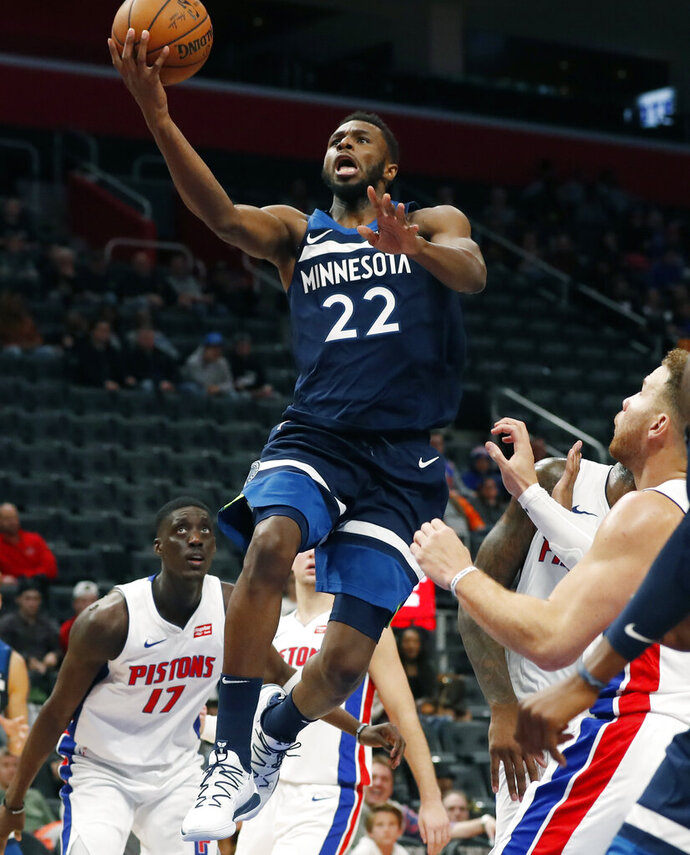 Minnesota Timberwolves forward Andrew Wiggins (22) makes a layup during the second half of an NBA basketball game against the Detroit Pistons, Monday, Nov. 11, 2019, in Detroit. (AP Photo/Carlos Osorio)