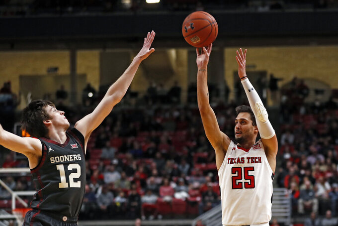 Texas Tech's Davide Moretti (25) shoots the ball over Oklahoma's Austin Reaves (12) during the first half of an NCAA college basketball game Tuesday, Feb. 4, 2020, in Lubbock, Texas. (Brad Tollefson/Lubbock Avalanche-Journal via AP)