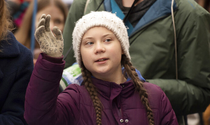 Swedish climate activist Greta Thunberg gestures as she attends a protest rally in Hamburg, Germany, Friday, March 1, 2019. (Daniel Reinhardt/dpa via AP)