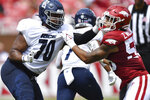 Rice offensive lineman Jovaun Woolford (70) and Arkansas defensive lineman Zach Williams (56) during the first half of an NCAA college football game Saturday, Sept. 4, 2021, in Fayetteville, Ark. (AP Photo/Michael Woods)