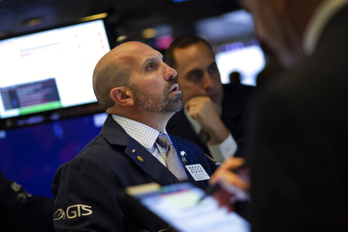 FILE - In this Sept. 18, 2019, file photo trader James Denaro works at the New York Stock Exchange. The U.S. stock market opens at 9:30 a.m. EDT on Tuesday, Sept. 24. (AP Photo/Mark Lennihan, File)