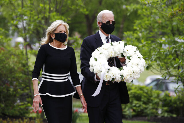 Democratic presidential candidate, former Vice President Joe Biden and Jill Biden, arrive to lay a wreath at the Delaware Memorial Bridge Veterans Memorial Park, Monday, May 25, 2020, in New Castle, Del. (AP Photo/Patrick Semansky)