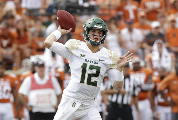 Baylor quarterback Charlie Brewer (12) throws against Texas during the first half of an NCAA college football game, Saturday, Oct. 13, 2018, in Austin, Texas. (AP Photo/Eric Gay)