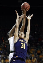 Baylor center Kalani Brown, rear, reaches up to collect a rebound over California center Kristine Anigwe (31) in the first half of a second-round game in the NCAA women's college basketball tournament in Waco, Texas, Monday, March 25, 2019. (AP Photo/Tony Gutierrez)