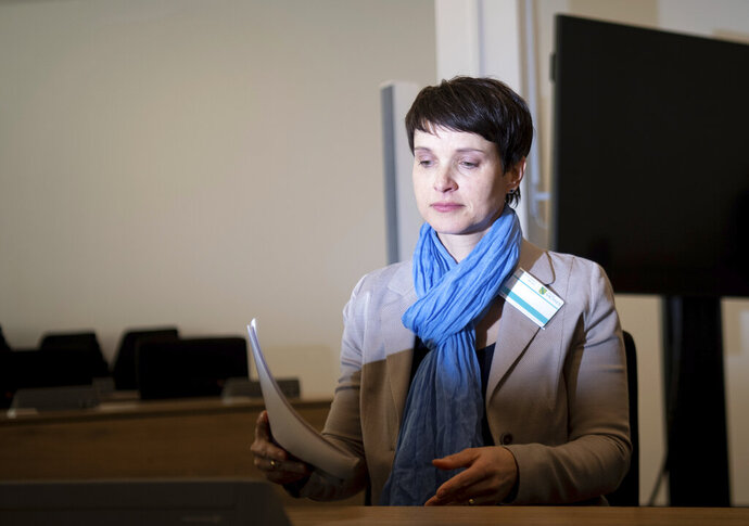 Former chairwomen of the German Alternative for Germany, AfD, party Frauke Petry arrives at the regional court in Dresden, Germany, Monday, Feb. 18, 2019. Petry appeared Monday before the court to defend herself against accusations she made false statements to parliament while under oath. (Monika Skolimowska/dpa-Zentralbild Pool/dpa via AP, pool)