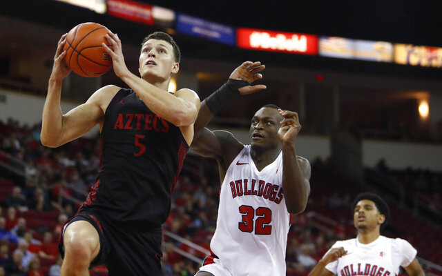 San Diego State's Yanni Wetzell drives past Fresno State's Nate Grimes during the second half of an NCAA college basketball game in Fresno, Calif., Tuesday Jan. 14, 2020. (AP Photo/Gary Kazanjian)