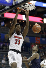 Louisville's Steven Enoch (23) dunks past Notre Dame's Juwan Durham (11) during the first half of an NCAA college basketball game in the Atlantic Coast Conference tournament in Charlotte, N.C., Wednesday, March 13, 2019. (AP Photo/Nell Redmond)