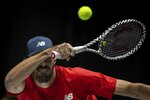 USA player Reilly Opelka returns the ball to Canada's Vasek Pospisil during their Davis Cup tennis match in Madrid, Spain, Tuesday, Nov. 19, 2019. (AP Photo/Bernat Armangue)