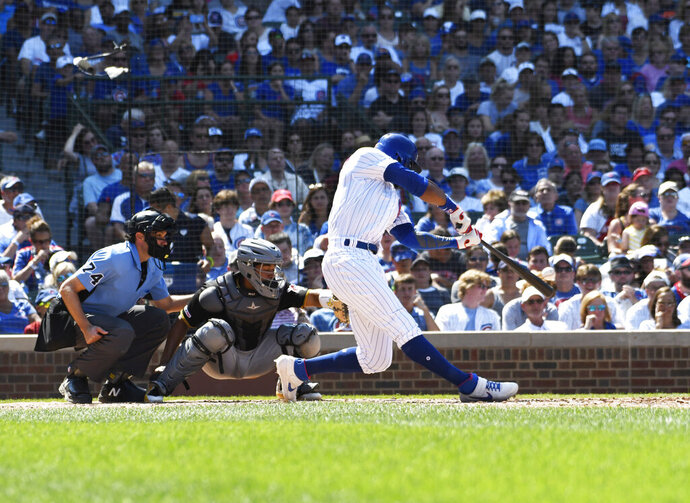 Chicago Cubs' Jason Heyward (22) hits a two-run home run against the Pittsburgh Pirates during the fifth inning of a baseball game, Sunday, July, 14, 2019, in Chicago. (AP Photo/David Banks)