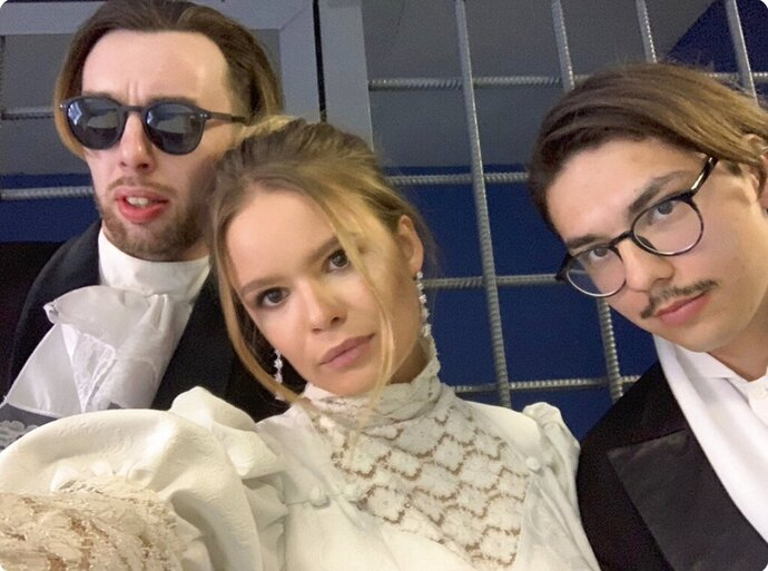 In this handout photo taken by Veronika Nikulshina, center, one of the Pussy Riot protest group who was detained along with two others as they were heading to attend a theater awards ceremony at the Bolshoi Theater poses for a selfie with her colleagues in Moscow, Russia, Tuesday, April 16, 2019. Fellow Pussy Riot member Verzilov tweeted that Nikulshina and her companions were nominated for the Golden Mask award. The reason for their detention wasn't immediately clear. (Veronika Nikulshina via AP)