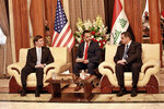 Iraqi Defense Minister Najah al-Shammari, right, meets with visiting U.S. Defense Secretary Mark Esper, left, at the Ministry of Defense in Baghdad, Iraq, Wednesday, Oct. 23, 2019. Esper has arrived in Baghdad on a visit aimed at working out details about the future of American troops that are withdrawing from Syria to neighboring Iraq. (AP Photo/Hadi Mizban)
