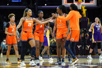 The Connecticut Sun celebrate a 75-57 win over the Los Angeles Sparks after their WNBA basketball game Thursday, Sept. 9, 2021, in Los Angeles. (AP Photo/Ashley Landis)