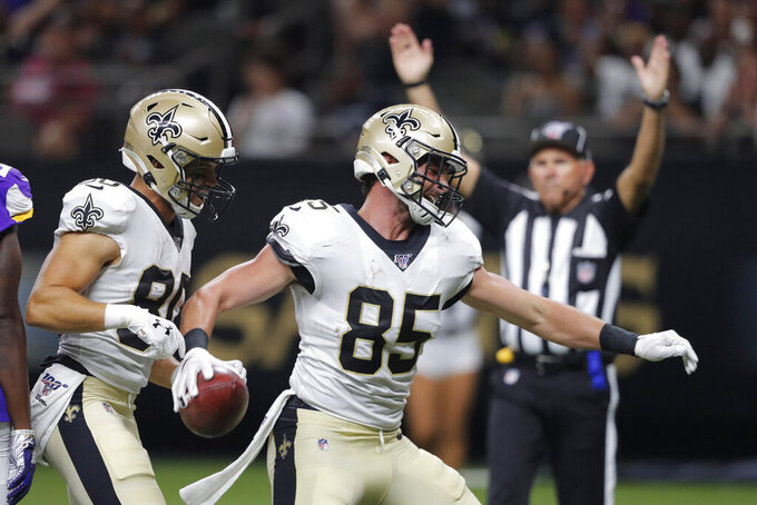 New Orleans Saints tight end Dan Arnold (85) celebrates his touchdown reception in the first half of an NFL preseason football game against the Minnesota Vikings in New Orleans, Friday, Aug. 9, 2019. (AP Photo/Bill Feig)