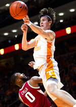 Tennessee forward John Fulkerson (10) passes the ball to a teammate during an NCAA college basketball game against Arkansas, Tuesday, Feb. 11, 2020 in Knoxville, Tenn. (Brianna Paciorka/Knoxville News Sentinel via AP)