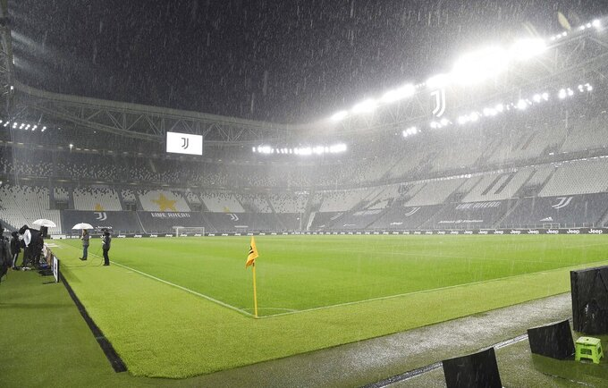 FILE - In this Sunday, Oct. 4, 2020 file photo, rain falls over the Allianz Stadium in Turin, ahead of the scheduled Serie A soccer match between Juventus and Napoli. Napoli won an appeal on Tuesday against its default 3-0 loss to Juventus and so the match will be rescheduled and the penalty point revoked. Napoli had seen previous appeals rejected and took the matter to the Italian Olympic Committee, which decided in favor of the club. (Tano Pecoraro/LaPresse via AP)