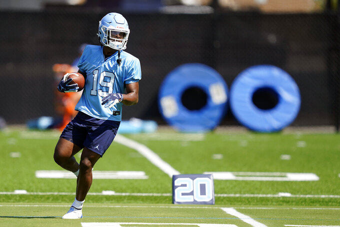 North Carolina running back Ty Chandler runs during an NCAA college football practice in Chapel Hill, N.C., Thursday, Aug. 5, 2021. (AP Photo/Gerry Broome)