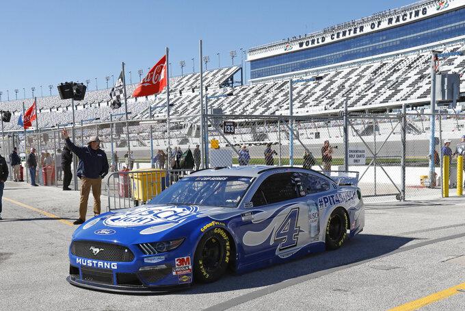 Kevin Harvick (4) returns to the garage after a NASCAR auto race practice at Daytona International Speedway, Saturday, Feb. 8, 2020, in Daytona Beach, Fla. (AP Photo/Terry Renna)