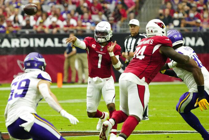 Arizona Cardinals quarterback Kyler Murray (1) throws against the Minnesota Vikings during the first half of an NFL football game, Sunday, Sept. 19, 2021, in Glendale, Ariz. (AP Photo/Rick Scuteri)
