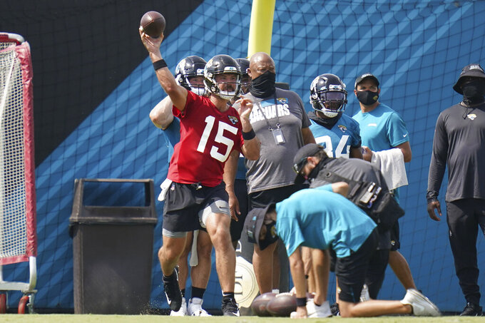Jacksonville Jaguars quarterback Gardner Minshew II (15) throws a pass during an NFL football workout, Wednesday, Aug. 12, 2020, in Jacksonville, Fla. (AP Photo/John Raoux)