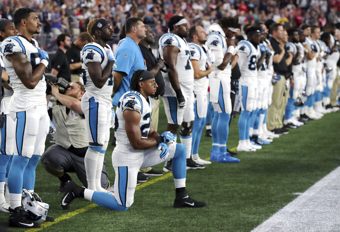 "FILE - In this Aug. 22, 2019, file photo, Carolina Panthers strong safety Eric Reid (25) kneels during the national anthem before the team's NFL preseason football game against the New England Patriots in Foxborough, Mass. NFL Commissioner Roger Goodell reiterated the league's support for players fighting for racial justice and protesting police violence. Citing a police officer shooting Jacob Blake in the back on Aug. 23 in Kenosha, Wisconsin, Goodell said the incident has ""brought forth more feelings of anger, frustration, anguish, fear for many of us in the NFL family."" The investigation into the police shooting of Blake, who is Black, is ongoing. (AP Photo/Charles Krupa, File)"