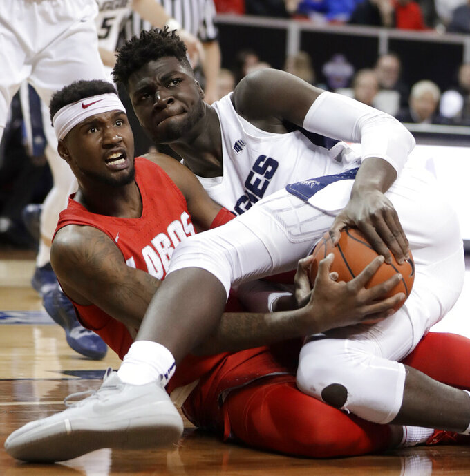 Utah State's Neemias Queta, right, and New Mexico's Carlton Bragg look for the call about possession of the ball during the second half of an NCAA college basketball game in the Mountain West Conference men's tournament Thursday, March 14, 2019, in Las Vegas. (AP Photo/Isaac Brekken)