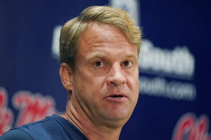Mississippi football coach Lane Kiffin answers a reporter's question following an NCAA college football practice on the Oxford, Miss., campus, Monday, Aug. 9, 2021. (AP Photo/Rogelio V. Solis)