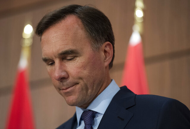 Minister of Finance Bill Morneau announces his resignation during a news conference on Parliament Hill in Ottawa, on Monday, Aug. 17, 2020.  (Justin Tang/The Canadian Press via AP)