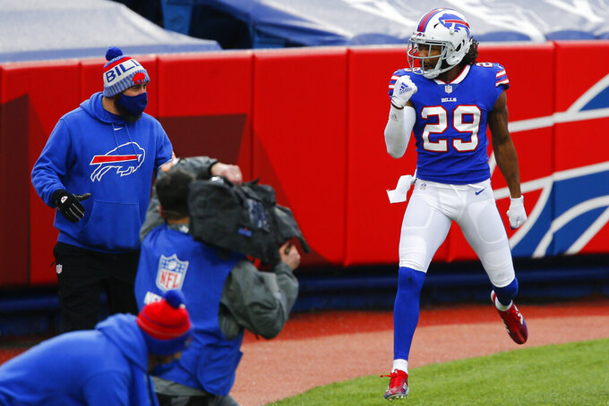 Buffalo Bills cornerback Josh Norman (29) celebrates his touchdown for the cameras in the second half of an NFL football game against the Miami Dolphins, Sunday, Jan. 3, 2021, in Orchard Park, N.Y. (AP Photo/John Munson)