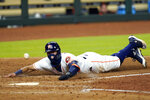 Houston Astros' Carlos Correa scores on a wild pitch thrown by San Francisco Giants relief pitcher Caleb Baragar during the sixth inning of a baseball game Wednesday, Aug. 12, 2020, in Houston. (AP Photo/David J. Phillip)