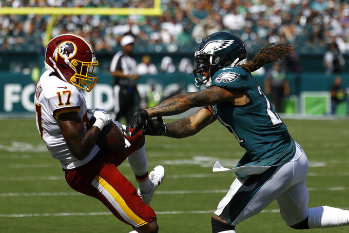Washington Redskins' Terry McLaurin, left, hangs onto a pass against Philadelphia Eagles' Ronald Darby during the first half of an NFL football game Sunday, Sept. 8, 2019, in Philadelphia. (AP Photo/Michael Perez)